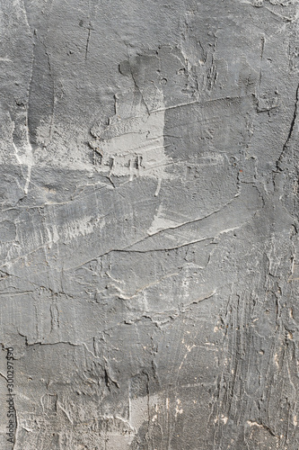 Fotomural The texture of gypsum or alibaster cracked plaster on the wall is a thick layer