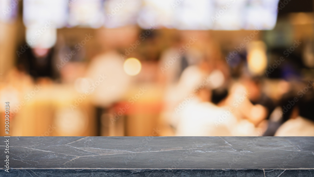 Fototapety, obrazy: Empty black marble stone table top and blurred bokeh cafe and restaurent interior background with vintage filter - can used for display or montage your products.