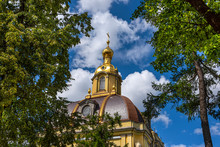Russia, Saint Petersburg, Near Neva River Peter And Paul Fortress: Beautiful Dome Of Famous Grand Ducal Burial Vault Mausoleum Near City Center Of The Russian Town With Green Trees And Blue Sky.