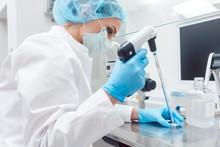 Scientist In Lab Conducting Bi...