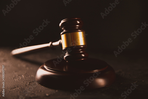 Law and justice concept. Dark gavel on the wooden table