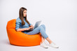 canvas print picture - Full size profile side photo of serious concentrated girl work on her computer chat with start-up clients sit big bag lounge chair wear casual style clothing isolated over white color background
