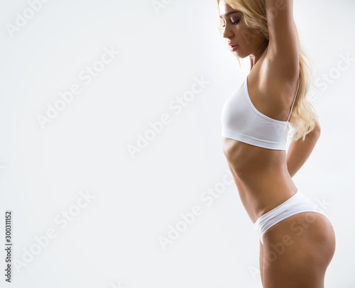 Beautiful fitness woman on a white background.