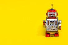 Antique Tin Toy Robot On Yello...
