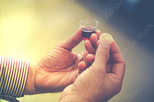 Man holding bread and wine in a Holy communion. Fototapet