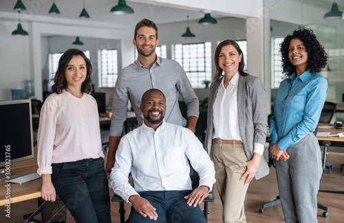 Diverse team of smiling businesspeople working in a modern office