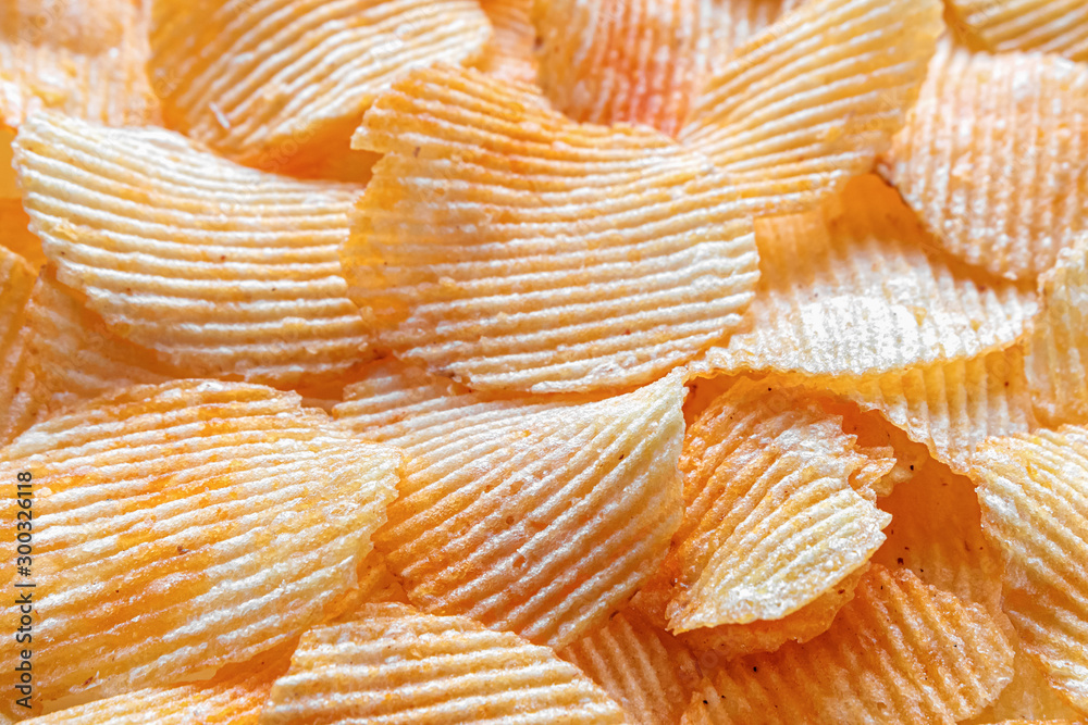 Fototapety, obrazy: Background of corrugated fried potato chips. Top view, selective focus.