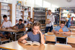 Schoolers reading in college library