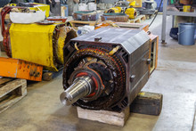 Disassembled Large Electric Motor In A Repair Shop