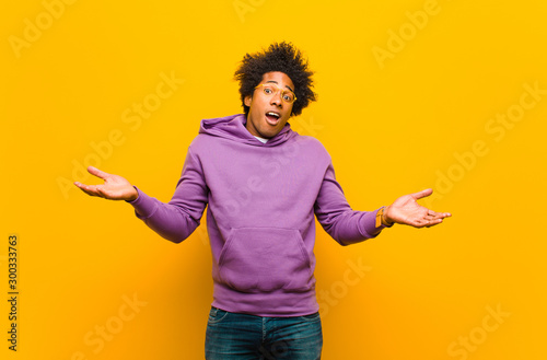 young black man feeling puzzled and confused, unsure about the correct answer or Canvas Print