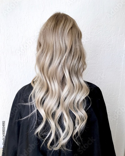 Leinwand Poster Long blond hair with balayage