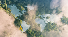 Aerial View Of Misty Rainforest Lakes In Shape Of World Continents In Dense Jungle Vegetation In Beautiful Late Evening Light. 3d Rendering