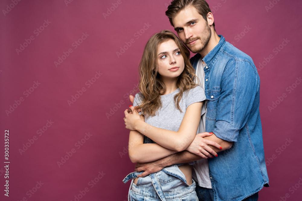 Fototapeta Happy loving couple isolated isolated on pink background.