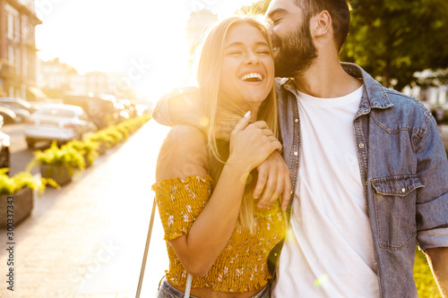 Happy lovely young couple in love spending time outdoors