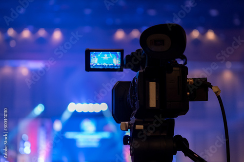 Tv OB camera in a concert or conference hall Wallpaper Mural