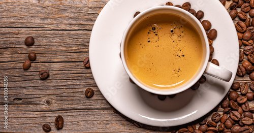 Canvas Prints Cafe White cup of aromatic black coffee on a wooden table.
