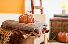 Pumpkin With Plaids On Table In Room