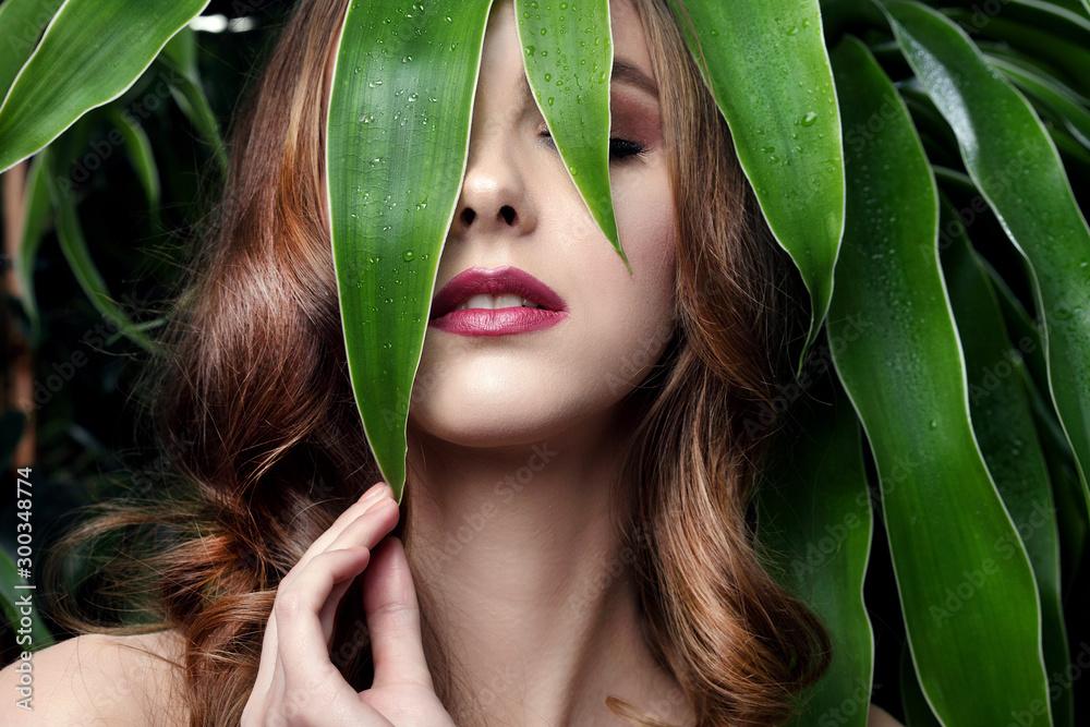 Fototapeta beautiful girl and green leaves