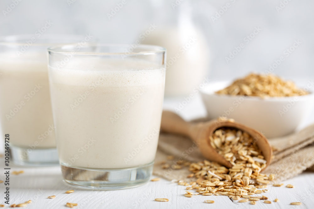 Fototapety, obrazy: Oat milk. Healthy vegan non-dairy organic drink with flakes