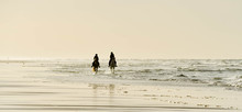 Two Horse Riders On The Beach ...