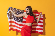 Attractive Young Cheerful Woman Showing American Flag