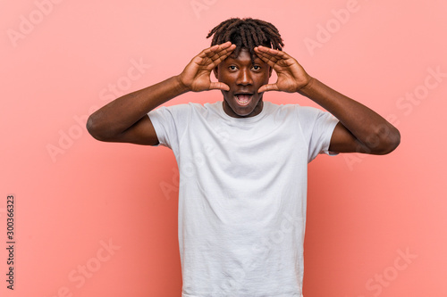 Fototapeta  Young african black man keeping eyes opened to find a success opportunity