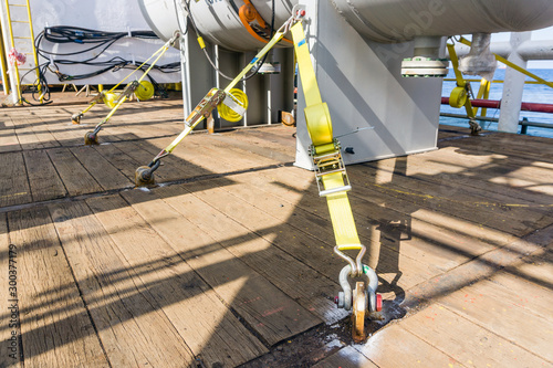 Fotomural  Chemical vessel secured to a construction barge deck