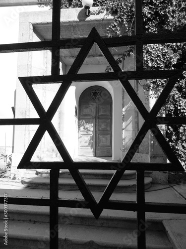 close-up of david's star in the middle of the synagogue door Fototapeta