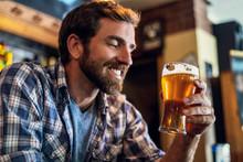 Smiling Man Looking At Beer Gl...