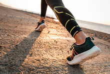 Sports And Running. A Woman Ru...