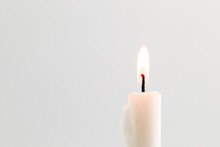 White Candle Flame On Black Ba...