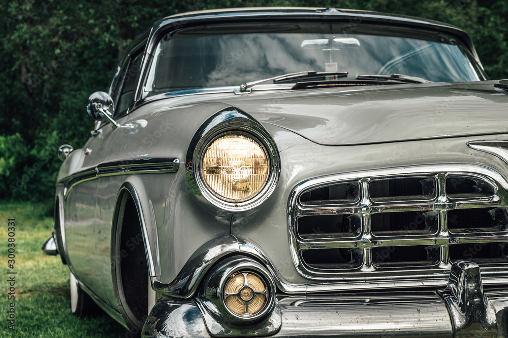 Fototapeta Classic car from the early fifties with large chromed grille