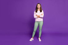 Full Length Body Size Photo Of Cheerful Pretty Gorgeous Youngster Standing Confidently With Hands Folded Smiling Toothily Isolated Over Purple Vivid Color Background