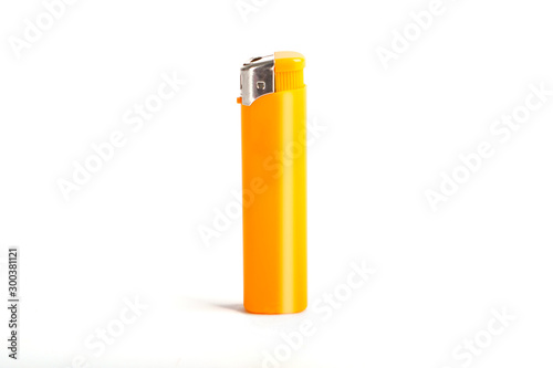 Photo Yellow cigarette lighter isolated on a white