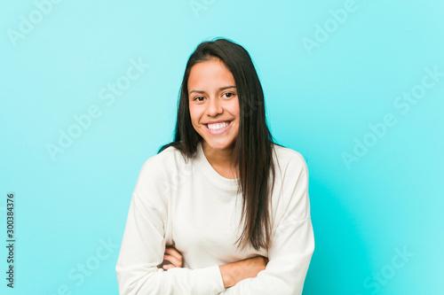 Young pretty hispanic woman laughing and having fun. Obraz na płótnie