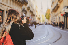 Selevtive On Photographer's Hand Taking Photo On Street With Tram Rails And Saint Andre Cathedral In Bordeaux, France