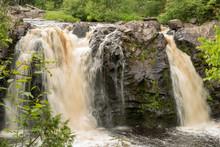 Dual Waterfalls Cascade Into A...
