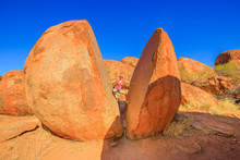 Tourist Woman Wedged Balancing...