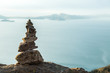 Leinwanddruck Bild - A pile of stones with the Titicaca lake in the background on Amantani Island in Puno, Peru