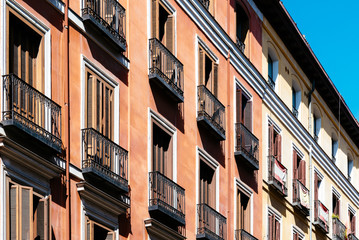 Old colorful and beautiful facades in old town of Madrid