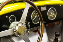Steering Wheel Of An Old Yellow Car