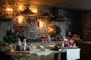 Fototapeta na wymiar Cozy and warm kitchen with Christmas decor. Happy New Year