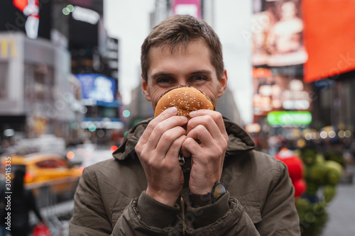 Man has fun with junk food in the city of new york Canvas Print