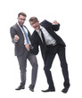 in full growth. two happy dancing young businessmen
