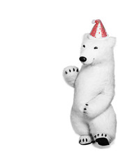Polar Bear Toy In Red Cap Waving His Hand In Greeting. Polar Bear Isolated On White Background