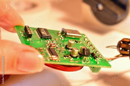 Fotografie, Tablou  Repairing a microchip detail