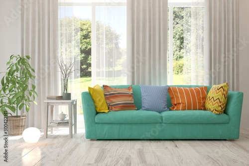 Montage in der Fensternische Honig Stylish room in white color with sofa and summer landscape in window. Scandinavian interior design. 3D illustration