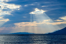Crepuscular Rays Over The Sea.