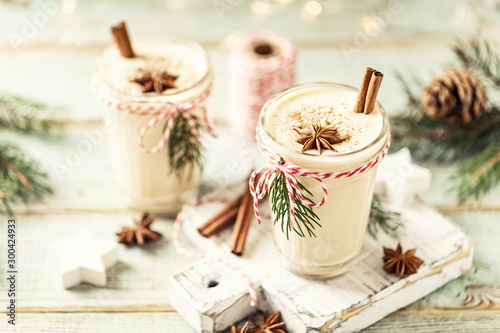 Obraz Eggnog. Traditional Christmas drink, spiced egg-milk cocktail with nut topping. - fototapety do salonu