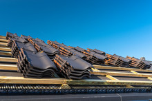 Roof Ceramic Tile Arranged In Packets On The Roof On Roof Battens. Preparation For Laying Roof Tiles.